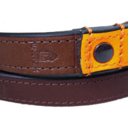 An Alice Foxx Lee dog lead with neon orange handle in Italian Veg Tan leather - stitching and logo detail