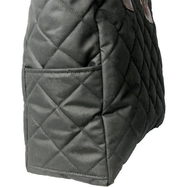Alice Foxx Chelsea Bag in quilted black waxed cotton - close detail of exterior pockets.
