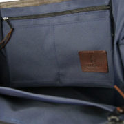 Alice Foxx Chelsea Bag in quilted navy waxed cotton- close detail of interior zipped pockets.