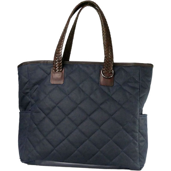 Alice Foxx Chelsea Bag in quilted navy waxed cotton, with woven Italian Vegetable tanned leather handles and gun-metal hardware.