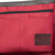 Alice Foxx Chelsea Bag in quilted red waxed cotton - close deatil of interior zipped pockets.