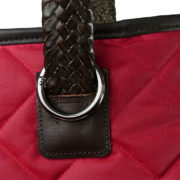Alice Foxx Chelsea Bag in quilted red waxed cotton - close detail on woven leather handle and gun-metal hardware.